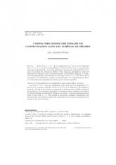 Compactifications des espaces de configuration dans les schémas de Hilbert