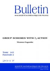 Schémas en groupes avec $\mathbb F_q$-action