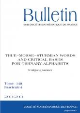 Mots de Thue-Morse-Sturm et bases critiques pour les alphabets ternaires